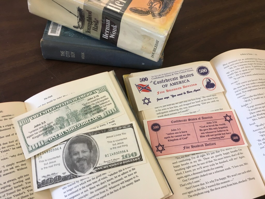 Dozens of inserts made to look like counterfeit bills were found in multiple books from the Curtis Memorial Library in Brunswick.