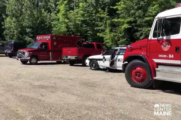 First responders from multiple departments search the Saco River in Buxton on Friday for a teenager who went into the river and never resurfaced.