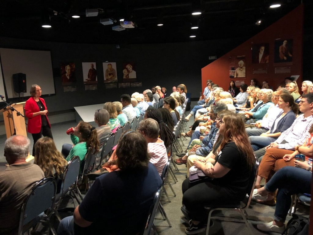 """Holocaust and Human Rights Center of Maine executive director Shenna addresses the crowd Wednesday prior to a talk, """"It's not over: Slavery Then, Racism Now,"""" by Shay Stewart-Bouley, executive director of Community Change Inc. and author of the blog, """"Black Girl in Maine."""""""