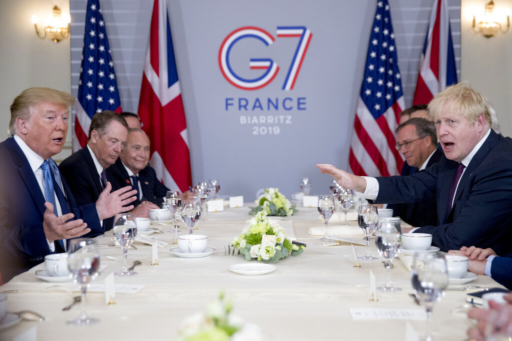 President Trump and Britain's Prime Minister Boris Johnson, right, attend a working breakfast at the Hotel du Palais on the sidelines of the G-7 summit in Biarritz, France, Sunday.