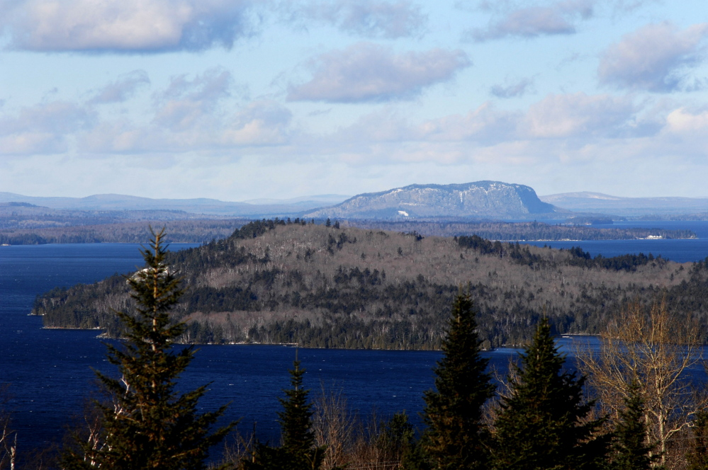 Mount Kineo rises behind Moosehead Lake. Weyerhaeuser  owns hundreds of thousands of acres in the Moosehead Lake region.