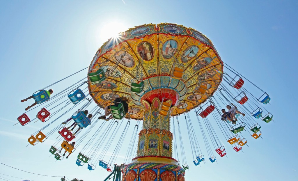 Riders fly through the air on the swings Sunday at the Cumberland County Fair in Cumberland.