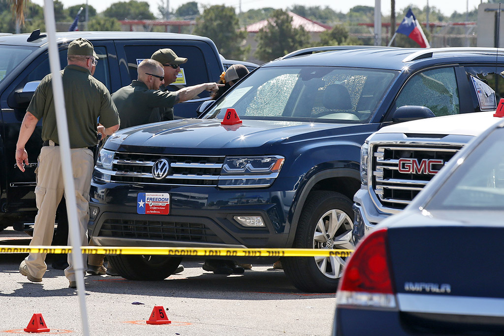 Officials continue working Monday at the scene in Odessa, Texas, where teenager Leilah Hernandez was fatally shot at a car dealership during Saturday's shooting rampage.