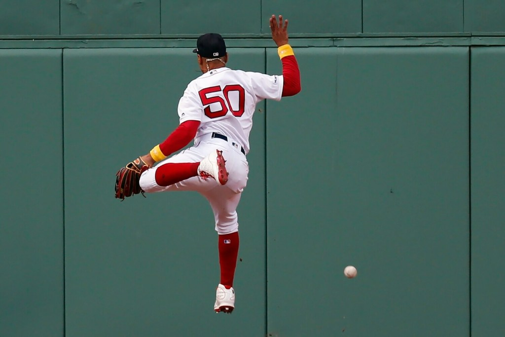 Mookie Betts can not make the catch on a ball hit by New York's Luke Voit which resulted in a double in the eighth inning of the Yankees' 5-1 win on Saturday at Fenway Park.