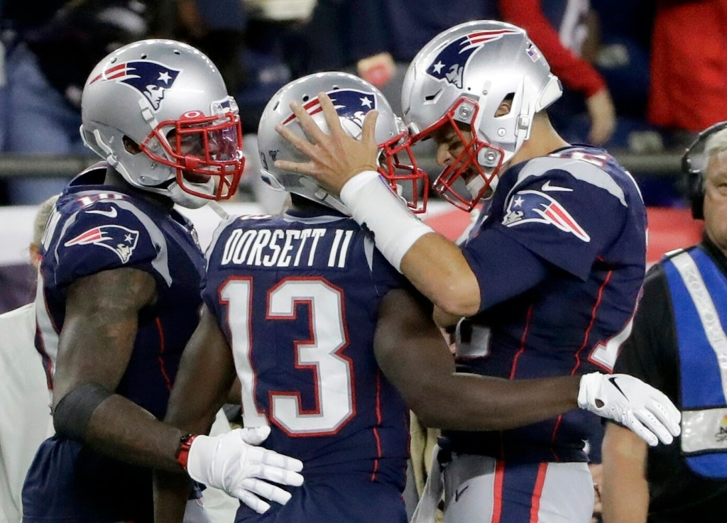New England Patriots quarterback Tom Brady, right, celebrates after Brady threw a 10-yard touchdown pass to Dorsett in the second half against Pittsburgh on Sunday in Foxborough, Mass. Brady threw three touchdown passes and the Pats won 33-3.