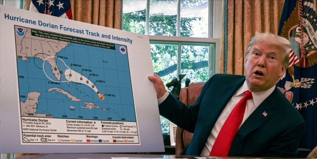 """Trump displays a modified National Hurricane Center """"cone of uncertainty"""" forecast  graphic which was  altered with a marker to indicate a risk that the storm would move into Alabama from Florida."""