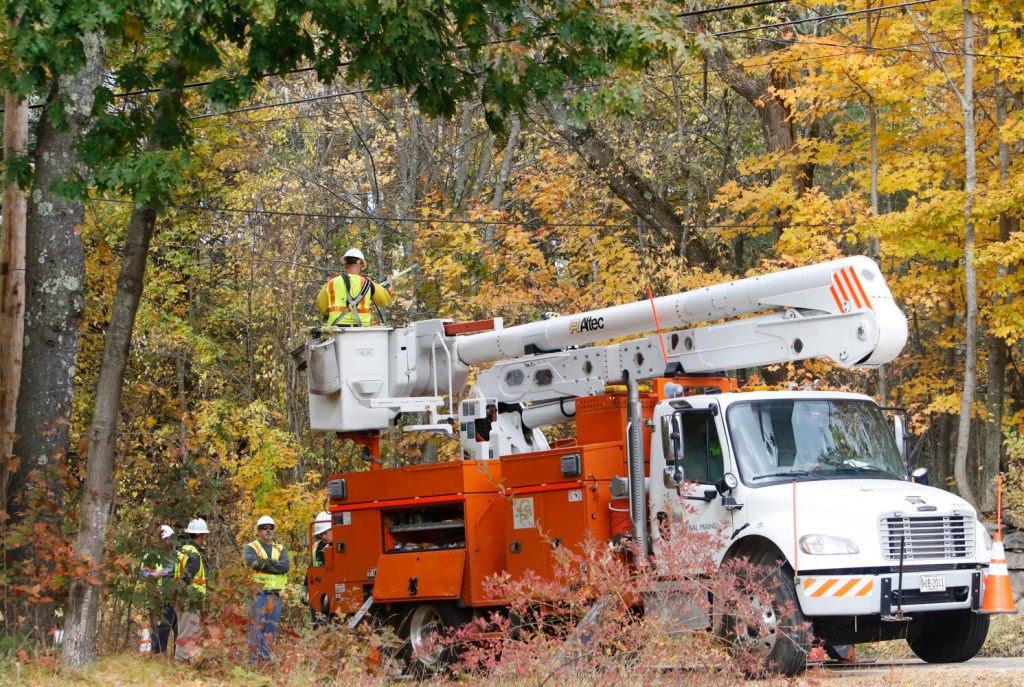Central Maine Power crews work to restore electricity along School Street in Alfred on Friday in the wake of a nor'easter last week.