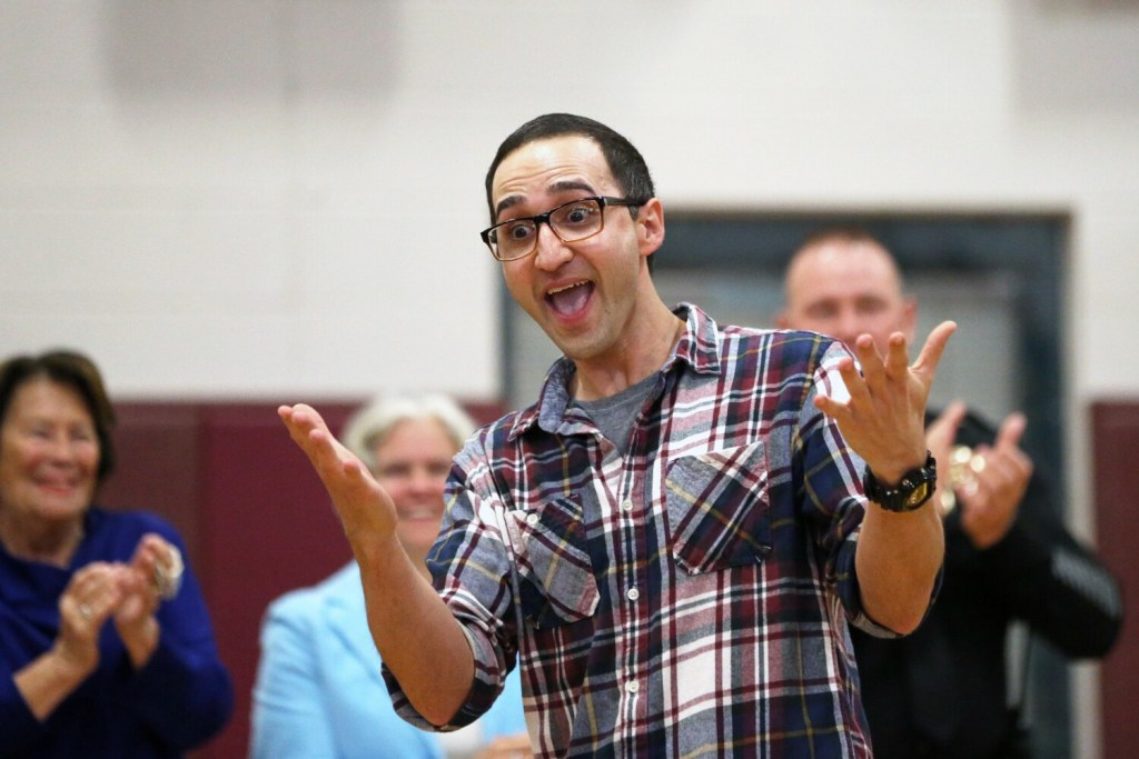 """Gorham High School teacher Adam Parvanta reacts to winning a Milken Educator Award during a surprise assembly at the school Wednesday morning. The awards, known as """"the Oscars of teaching,"""" recognize excellence annually with $25,000 awards to 40 teachers across the country."""