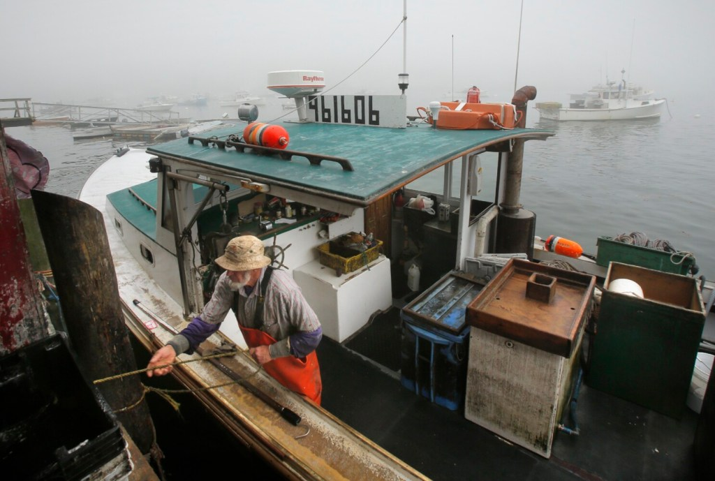 Bob Williams ties up at the bait shed at Greenhead Lobster in Stonington in early September 2016. Maine's top fisheries regulator said lobster landings this year are running about 38 percent behind hauls of recent years.
