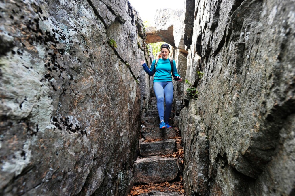 Lynette Gumbleton of Kalamazoo, Michigan, leads the way down the stairs on Homans Path in Acadia National Park in 2017. The path, along with the park's entire trail system, could be listed on the National Register of Historic Places.