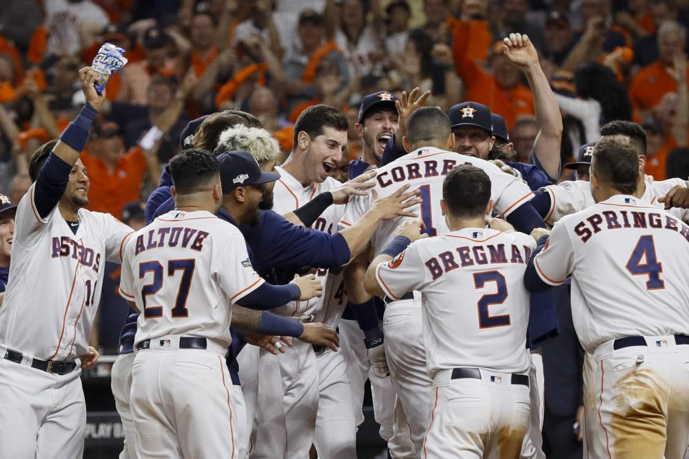 Houston's Carlos Correa celebrates with teammates after his walk-off home run against the New York Yankees during the 11th inning.