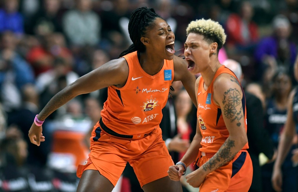 Connecticut Sun's Bria Holmes, left, and Natisha Hiedeman celebrate a basket against the Washington Mystics during  Game 4 of the WNBA finals Tuesday in Uncasville, Conn.