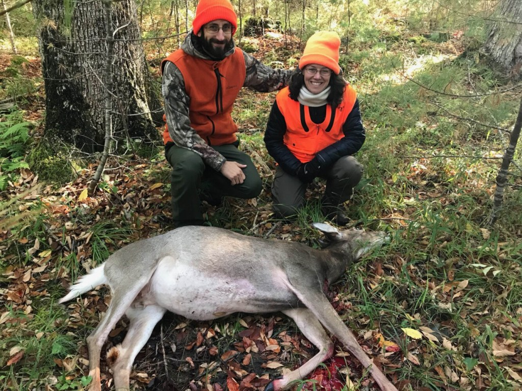 Rebecca Happnie-Yoder, right, proudly shows off the first deer she shot with her husband, Jordan Yoder, at Maine's first mentor hunt, held on Oct. 5 on Swan Island in Richmond. The mentor hunt was part of the state's efforts to encourage new hunters.