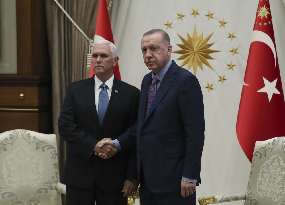 Vice President Mike Pence, left, and Turkish President Recep Tayyip Erdogan pose at the presidential palace in Ankara, Turkey, on Thursday.