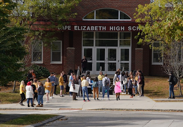 A group of students staged a walkout at Cape Elizabeth High School on Monday over the suspension of three students who posted notes calling out what they said was sexual abuse at the school.