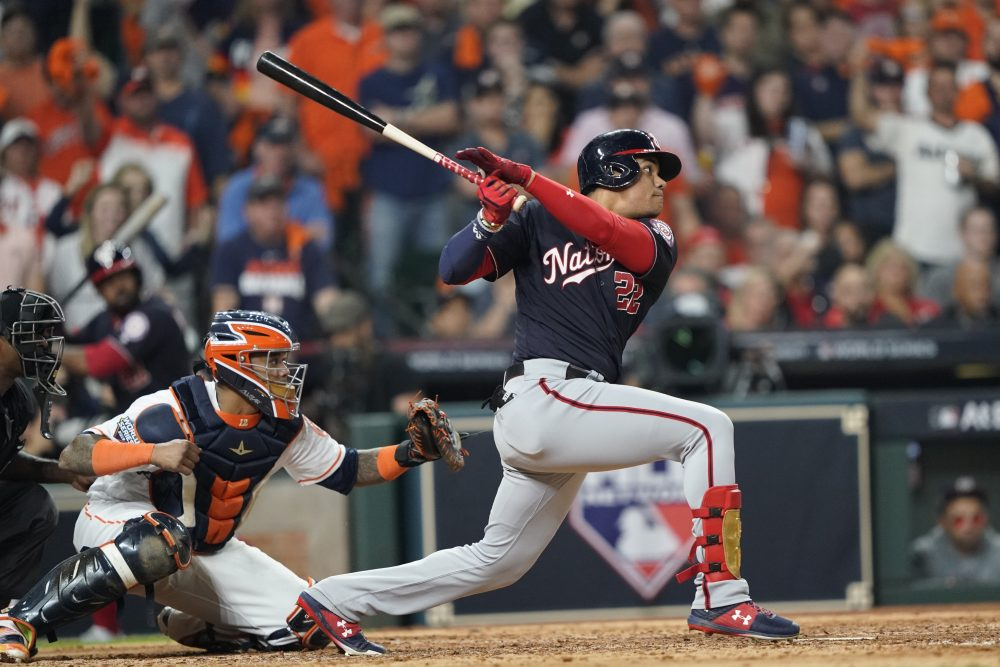 The Washington Nationals' Juan Soto hits a two-run double in the fifth inning of Game 1 of the World Series on Tuesday night in Houston. Soto powered Washington to a 5-4 win, driving in three runs.
