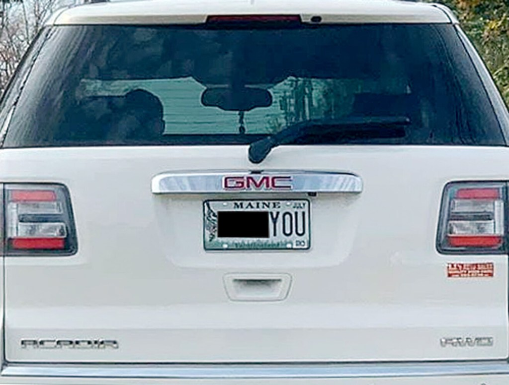 """On Oct. 20, Derek Volk took a photo of the  license plate on the vehicle in front of him, showing an expletive (we have blacked out the first word).  """"How did the state allow this on a license plate and who would put this on their car?"""" he wrote on a public Facebook post."""