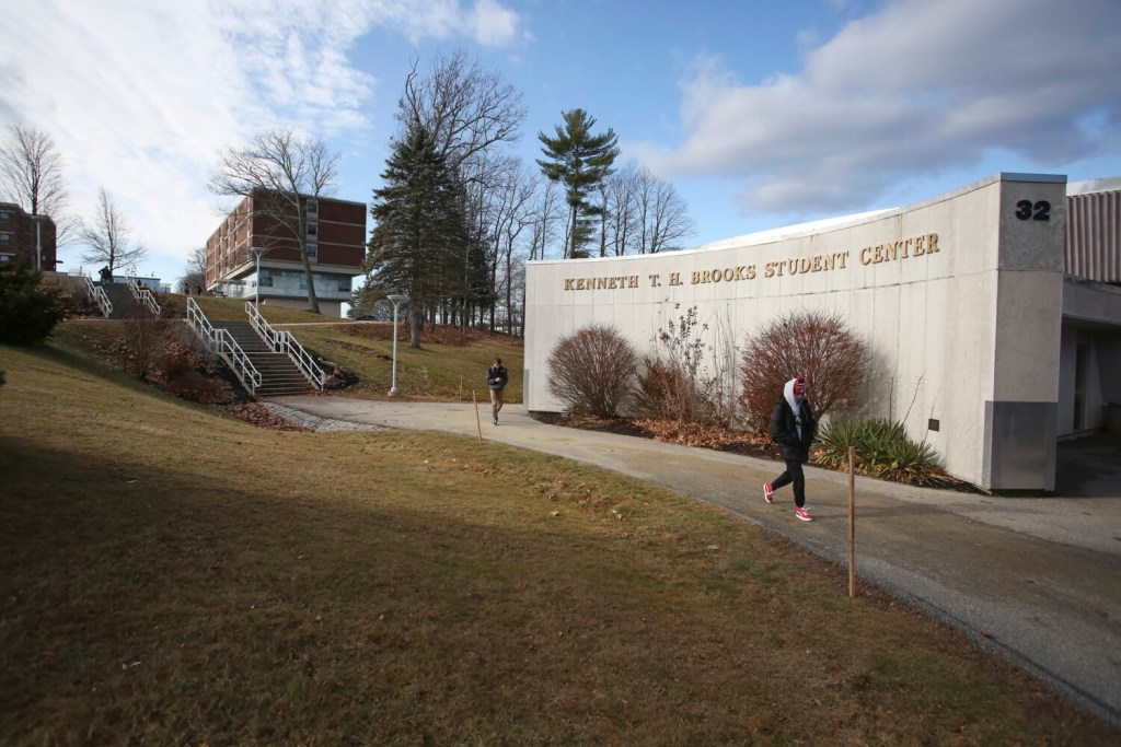 Students walk past the Kenneth T. H. Brooks Student Center on USM's Gorham campus Monday. Most of about 20 students who were interviewed said the proposal to rename their school the University of Maine at Portland is a bad idea.