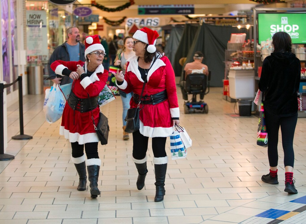 Doreen Shurtleff, left, and Diane Paterson, both of Lewiston, get into the spirit of holiday shopping at The Maine Mall on Friday. The sisters, who dress up to go shopping every year for Black Friday, had started their shopping in Freeport earlier and planned to shop in several other areas throughout the day.