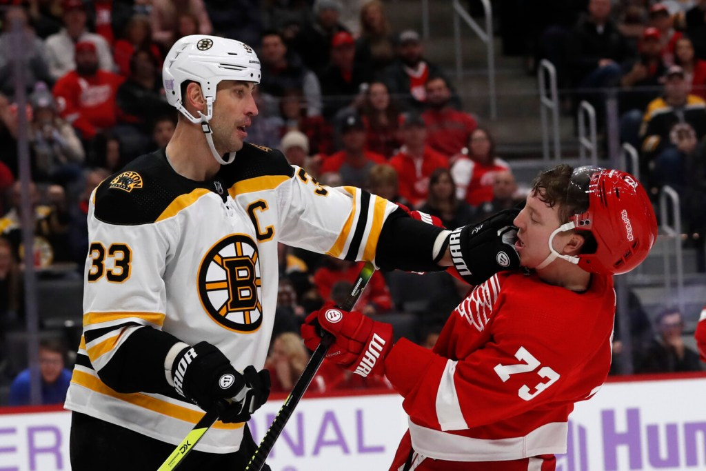 Boston  defenseman Zdeno Chara, left, pushes Detroit left wing Adam Erne during the second period of Friday's game in Detroit.