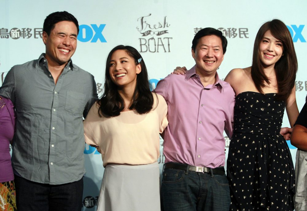 """In this Aug. 5, 2016 file photo, Randall Park, from left, Constance Wu, Ken Jeong and Ann Hsu pose for photographers during a media event announcing their comedy series """"Fresh off the Boat"""" in Taipei, Taiwan."""