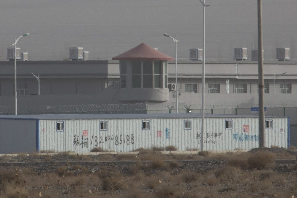 A guard tower and barbed wire fences are seen around a facility in the Kunshan Industrial Park in Artux in western China's Xinjiang region. According to people in contact with government employees, the Xinjiang government is deleting data, destroying documents, tightening controls on information and has held high-level meetings in response to leaks of classified papers on its mass detention camps for Uighurs and other predominantly Muslim minorities.