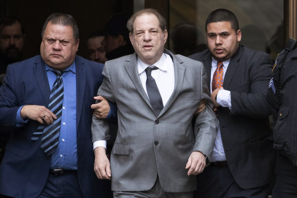 Harvey Weinstein, center, leaves court following a bail hearing Dec. 6 in New York.