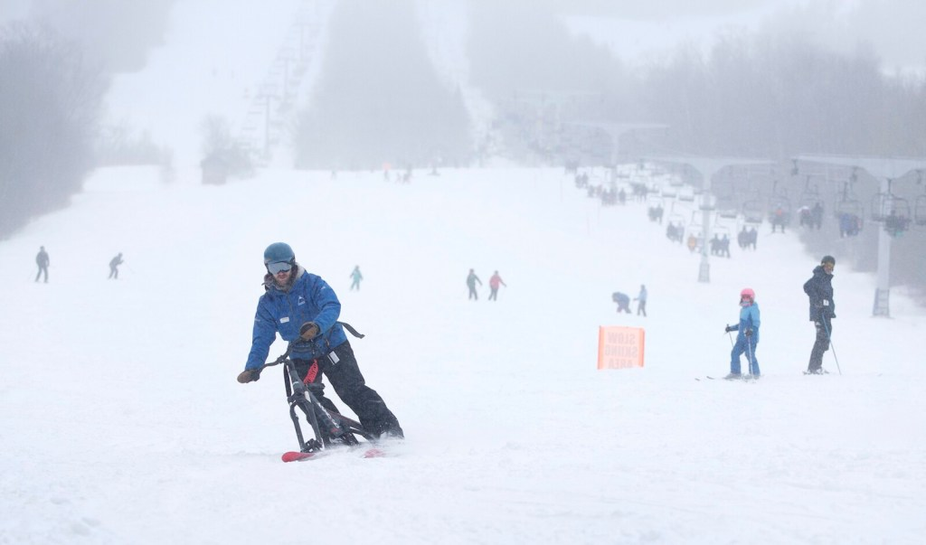 Mathias Ringley teaches a ski bike lesson at Sugarloaf ski resort. The sport of skibiking has have only just reached Maine.