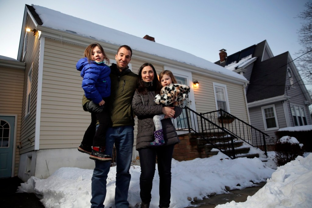 """The Adour family of South Portland, from left, Eva, Jason, Emily and Pearl, has been struggling to find a home in Cape Elizabeth, with a red-hot market and low housing stock. """"There's just a lack of inventory in our price range,' Emily said."""