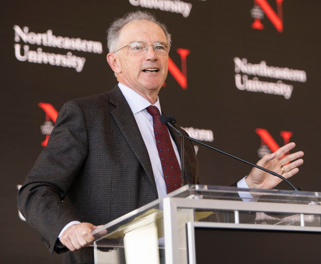 Lewiston tech entrepreneur David Roux  speaks about Northeastern University's future technology education center in Portland, which Roux is funding, during a news conference at the Portland Ocean Gateway on Monday.