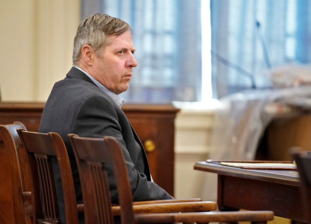 Bruce Akers sits in York County Superior Court in Alfred at the start of his trial on Monday. Akers is charged with murder in connection with the death of his neighbor Douglas Flint in Limington in 2016.