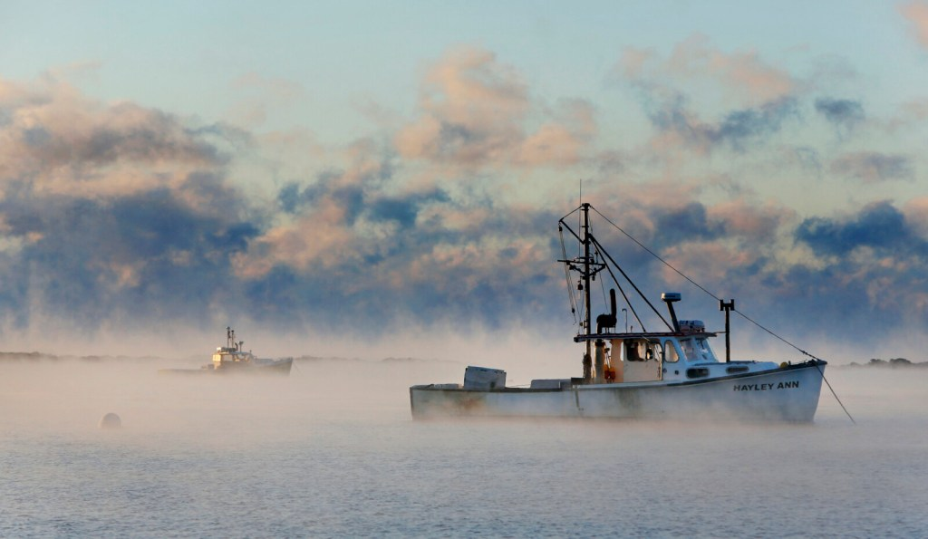 The Hayley Ann is moored amid rising sea smoke in Cape Porpoise Harbor in January 2015. The vessel sank Thursday, and its captain and deckhand died, the Coast Guard said.