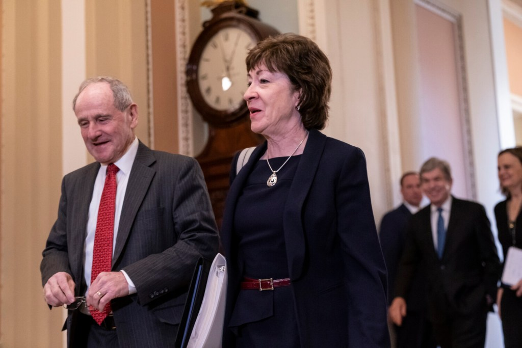 Sen. Jim Risch, R-Idaho, chairman of the Senate Foreign Relations Committee, left, walks with Sen. Susan Collins, R-Maine, as they arrive at the Senate for the start of the impeachment trial of President Trump on charges of abuse of power and obstruction of Congress, at the Capitol in Washington on Tuesday.