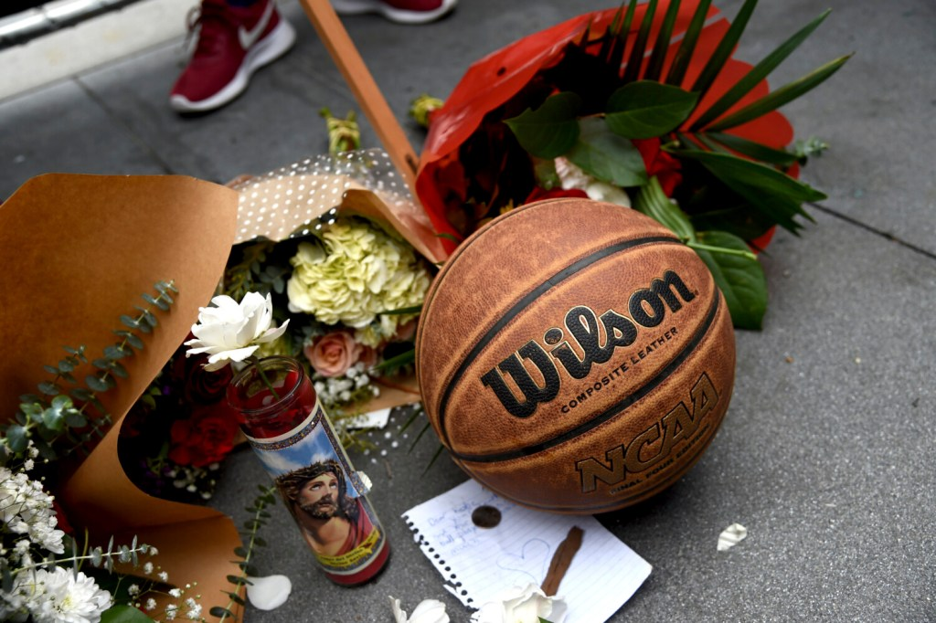 A makeshift memorial honoring former NBA basketball player Kobe Bryant appears outside of Staples center prior to the start of the 62nd annual Grammy Awards on Sunday, Jan. 26, 2020, in Los Angeles. Bryant died Sunday in a helicopter crash near Calabasas, Calif. He was 41. (AP Photo/Chris Pizzello)