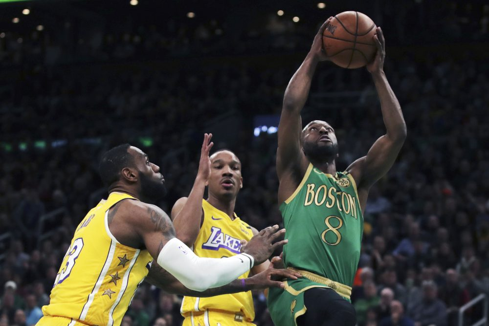 Celtics guard Kemba Walker drives to the basket past Lakers guard Avery Bradley, center, and forward LeBron James (23) during the first half of the Celtics' 139-107 win Monday in Boston.