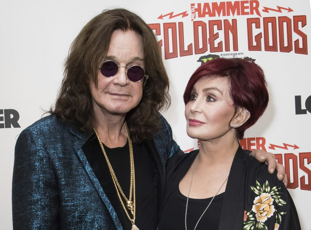 This June 11, 2018 file photo shows musician Ozzy Osbourne, left, and his wife Sharon Osbourne at the Metal Hammer Golden God awards in London.