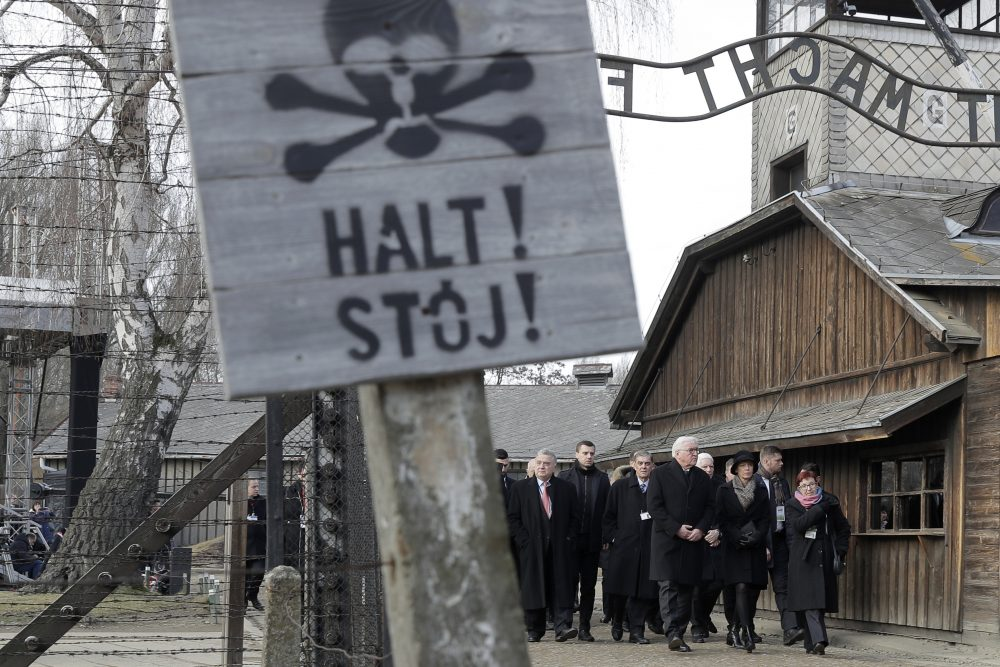 Germany's President Frank-Walter Steinmeier, center, and his wife Elke Buedenbender enter the Auschwitz I Nazi death camp in Oswiecim, Poland, Monday, Jan. 27, 2020.