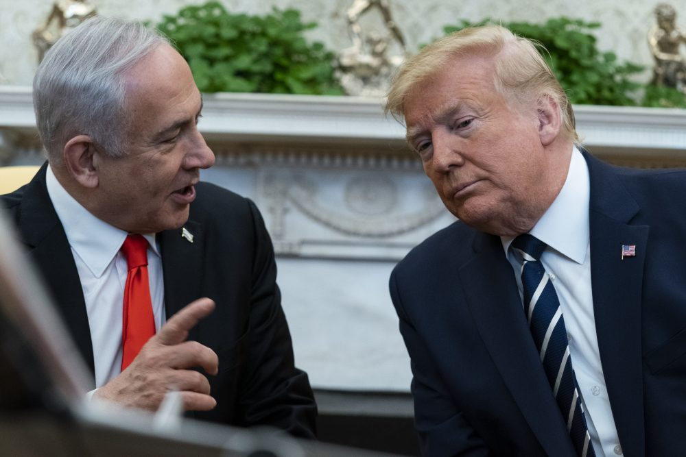 President Trump listens to Israeli Prime Minister Benjamin Netanyahu during a meeting in the Oval Office on Monday in Washington.