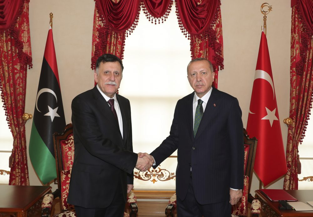 Turkey's President Recep Tayyip Erdogan, right, shakes hands with Fayez al Sarraj, the head of Libya's internationally-recognized government, prior to their meeting in Istanbul on Sunday. The meeting at Dolmabahce Palace took place on the first day of a ceasefire in Libya initiated by Turkey and Russia.