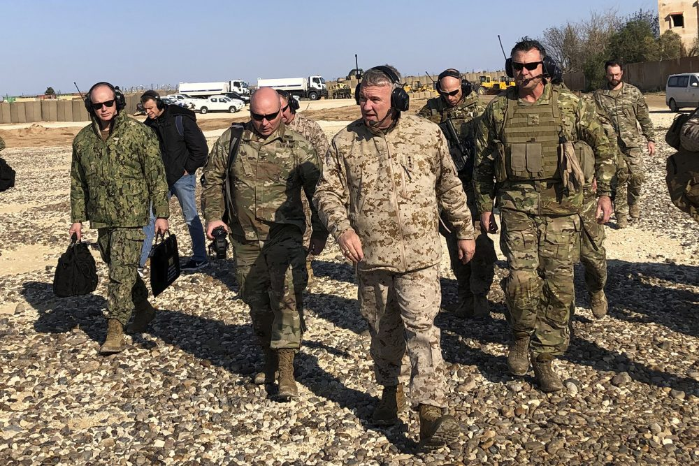 Gen. Frank McKenzie, center front, the top U.S. commander for the Middle East, visits a military outpost in Syria on Saturday. McKenzie made the unannounced visit to Syria, traveling to five different military outposts to meet with troops, hear from commanders and talk with the leader of the Syrian Democratic Forces.
