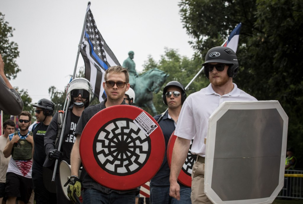 White nationalists rally at Emancipation Park in Charlottesville in 2017. Thousands are expected to show up for a gun-control protest on Monday in Richmond's Capitol Square. State and federal officials are preparing for a volatile mix of weapons, passions and anti-government fervor.