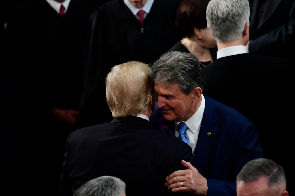 President Trump greets Sen. Joe Manchin, D-W.Va., after the 2018 State of the Union speech. Trump has interacted with Manchin more than any Democrat in the Senate. Manchin has come over for movie screenings and has been given tours by the president of the family residence and his private study.