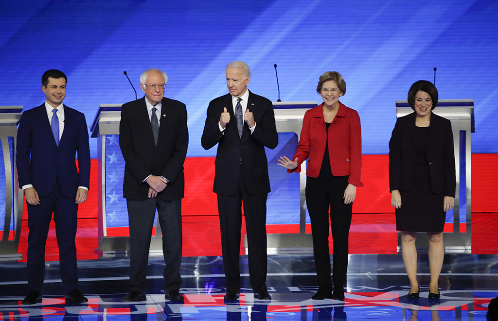 From left, Democratic presidential candidates Pete Buttigieg, Bernie Sanders, Joe Biden, Elizabeth Warren and Amy Klobuchar stand on stage before Friday's presidential debate at Saint Anselm College in New Hampshire.