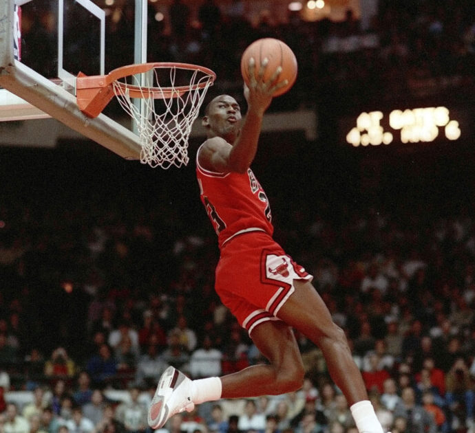 Michael Jordan throws one down during the 1988 slam-dunk competition of the NBA All-Star weekend in Chicago.  Jordan left the old Chicago Stadium that night with the trophy. To this day, many believe Wilkins was the rightful winner.