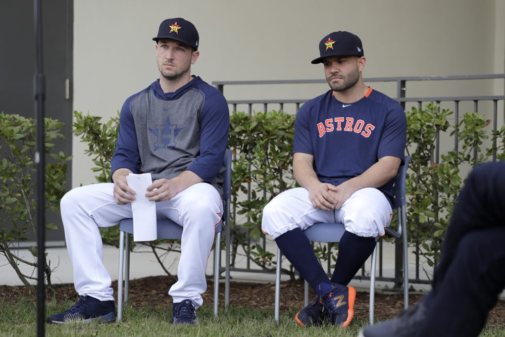 Houston Astros infielder Alex Bregman, left, and teammate Jose Altuve wait to deliver statements during a news conference before the start of the first official spring training baseball practice on Thursday morning.