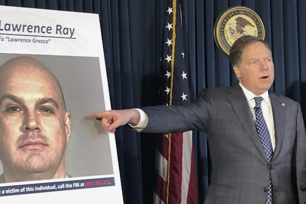 U.S. Attorney Geoffrey Berman points to a photo showing Lawrence Ray during a news conference, Tuesday in New York.  Ray, an ex-convict known for his role in a scandal involving former New York police commissioner Bernard Kerik, was charged Tuesday with federal extortion and sex trafficking charges involving a group of students at Sarah Lawrence College. (AP Photo/)