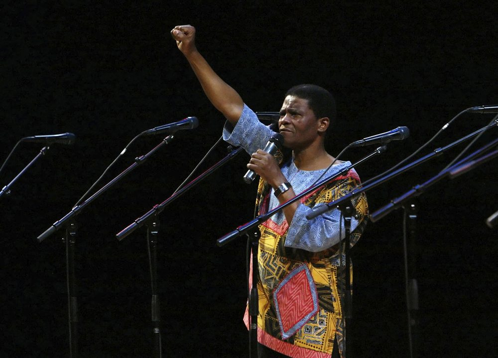 Ladysmith Black Mambazo founding member Joseph Shabalala gestures to the audience during the group's performance at the Kimmel Center in Philadelphia in 2008.