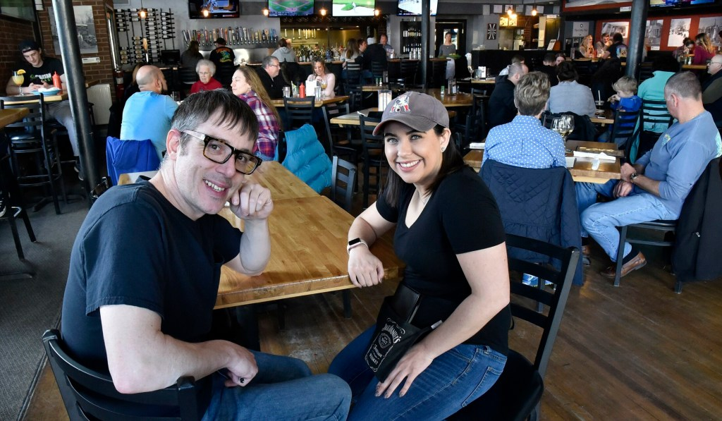 Silver Street Tavern employees Zack Denis and Samantha Clark take a break from serving customers Sunday to talk about the unprecedented $2,000 tip they and other employees will split from an anonymous customer at the Waterville restaurant on Saturday.