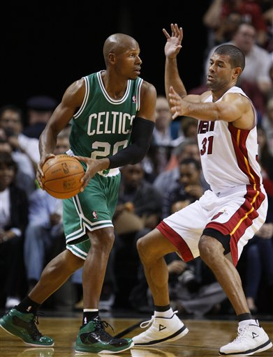 Boston Celtics guard Ray Allen, left, looks for an open teammate past Miami Heat forward Shane Battier on Tuesday in Miami.