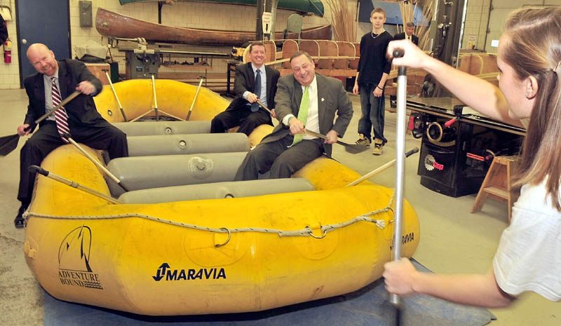 ROWERS: Gov. Paul LePage, right, Education Commissioner Stephen Bowen, in back, and Jonathan Nass follow instructions from student Meghan Orchard on how to paddle in a whitewater raft after announcement of education proposals at Somerset Career & Technical Center in Skowhegan on Wednesday.